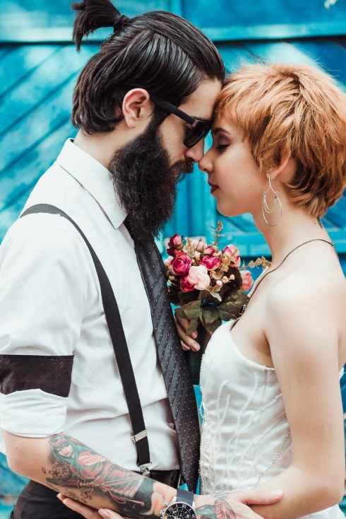 man in necktie and dress shirt standing near woman